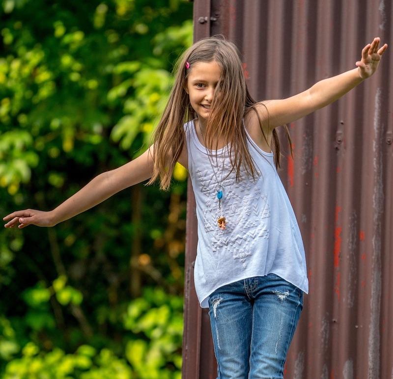 Small girl balancing