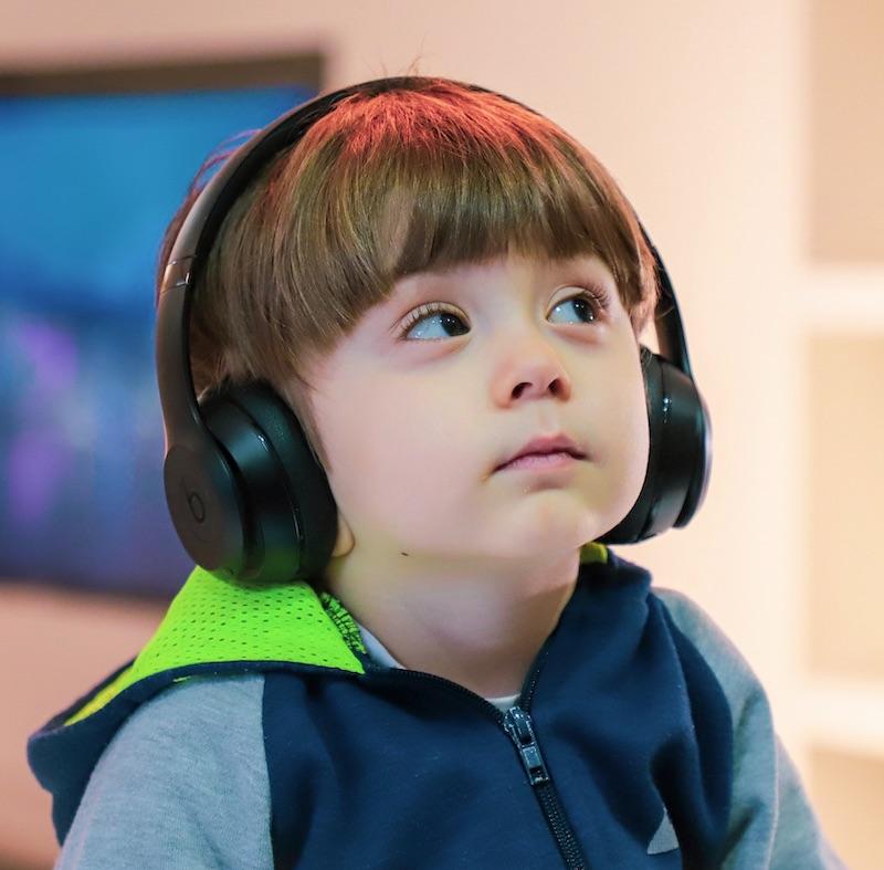 kid with headphones Alireza Attari on Unsplash